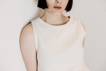 A girl wearing a white shirt