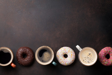 Coffee cups and colorful donuts