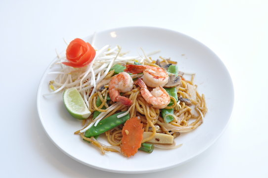 Mi Xao. Lo mein noodles stir-fried with your choice of meat chicken, beef or tofu and mixed vegetables