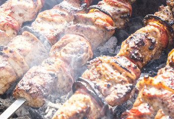 skewers of pork on the coals
