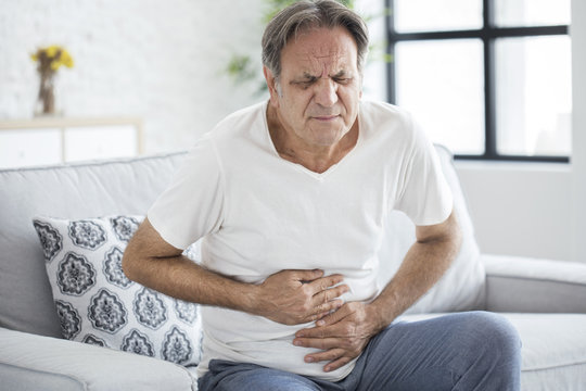 Senior man with stomach pain