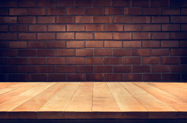 Empty wood table top with Brown brick wall background.