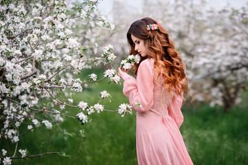 Pretty woman in a beautiful dress outdoor