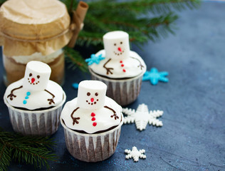 Baby capkey in the form of a melted snowman. New Year's dessert.