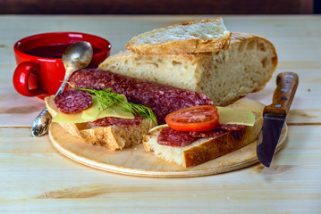Sandwiches with salami and cheese