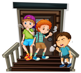 Three boys smoking cigarette on stairs