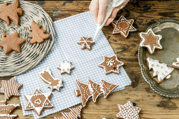 Decorating gingerbread cookies for christmas