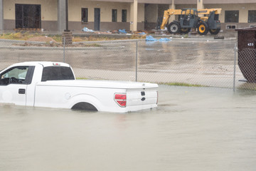 Pickup truck swamped by flood water in Humble, Texas,US by Harvey Tropical Storm. Flooded car under deep on heavy high water road. Disaster Motor Vehicle Insurance Claim Themed. Severe weather concept