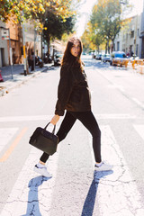 Beautiful woman on a crosswalk