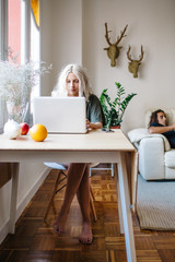 Woman on computer at home