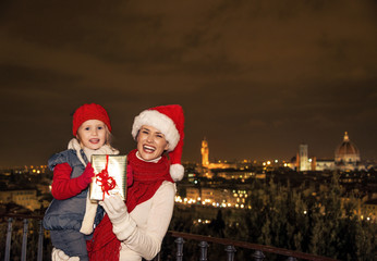 mother and daughter with Christmas present box in Florence