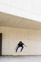 Guy flying on a skateboard.