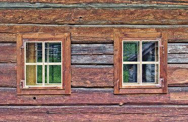 Log cabin wall with two windows