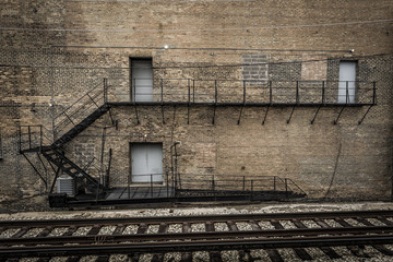 Side of brick building with metal fire escape
