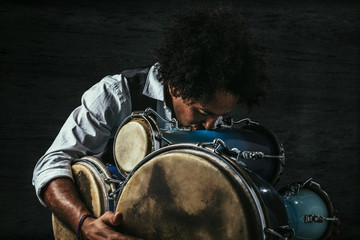 Afro Musician Kissing his Bata Drums