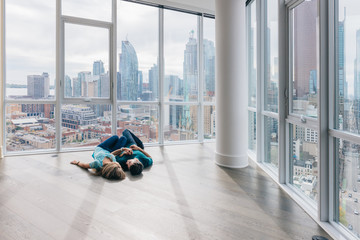Real Estate: young couple in their new condo