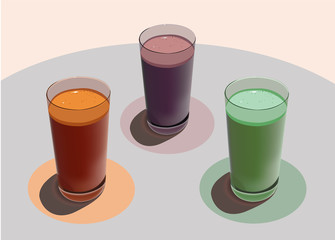 three glasses with freshly squeezed juices on a white table