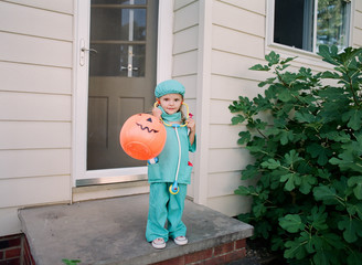 A little girl dressed up as doctor