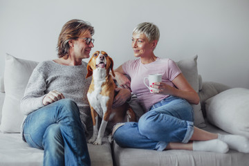 Mature couple enjoying early morning with their dog