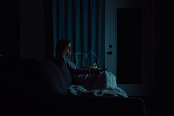 Girl watching TV alone