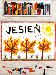 Photo  of  colorful drawing: Polish word AUTUMN and  trees with yellow, red and orange leaves