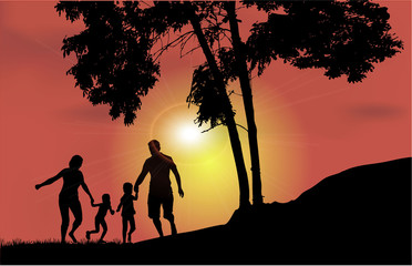 Family walk at sunset