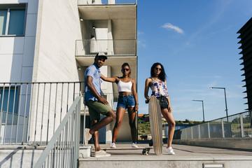 Stylish people posing with skates