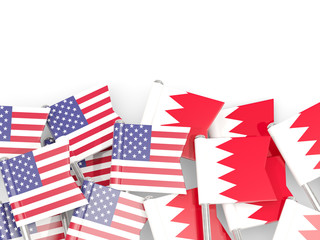 Flag pins of USA and Bahrain isolated on white. 3D illustration