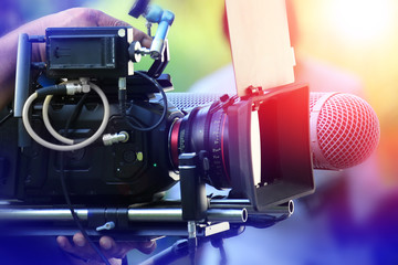 VDO grapher working with professional equipment in movie production.
