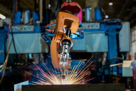 Robots welding in a car factory. Welding car body