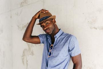 Stylish man posing with hat