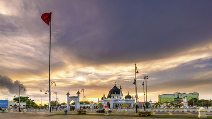 Dramatic sky during sunset with clouds above mosque