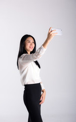 A young lady hold a phone to take self photo