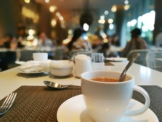 a hot milk coffee cup of coffee in a restaurant