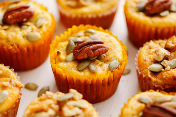Homemade muffins of pumpkin with pecans. Close up