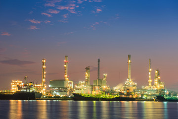 Transportation logistics and oil refinery plant at blue hour sunrise, Oil and Gas