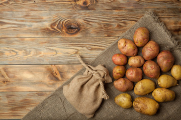 Potatoes on a rustic wooden background