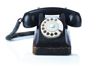 Old black phone isolated on  white.