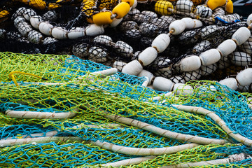 multi-colored fishing nets in a pile
