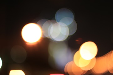 Bokeh Abstract background from car in street in night time. Elegant abstract background with bokeh defocused lights.