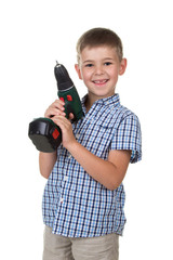 A small happy boy in the plaid shirt holds a screwdriver pretending he is a builder, isolated on white background