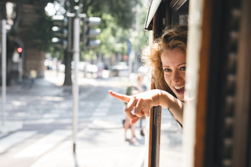 Young female tourist traveling on a tram