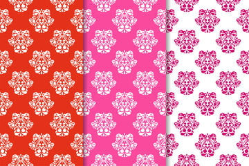 Red set of floral ornaments. Seamless patterns