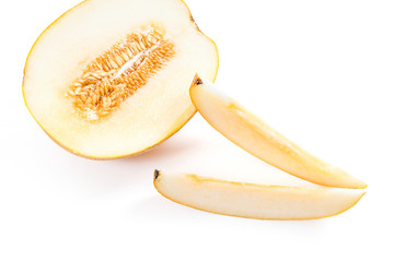 Sliced honeydew melon tropical fruit isolated on a white background.