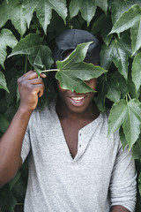 funny african american man holding a green leaf
