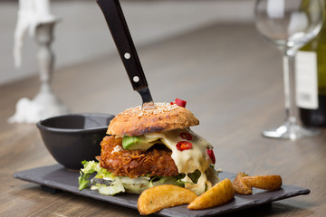 home made tasty chicken burgers on wooden table