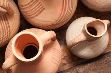Amphoras, vases and old clay jugs in a rural house