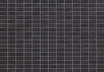 Black brick tile wall background seamless and texture