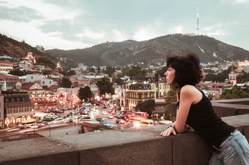 Fotomurales - Woman with the view on Tbilisi, Georgia