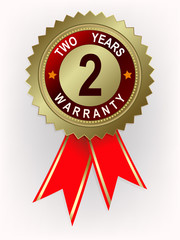 emblem of gold color with text two years warranty